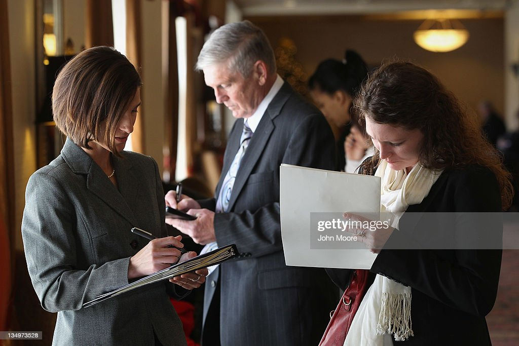 Job applicants register at the 'Denver Hires Job Fair' on December 5, 2011 in Denver, Colorado. Last week the U.S. government announced that the national unemployment rate has fallen to 8.6 percent, lower than most analysts had predicted.