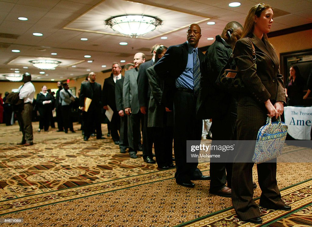 Job applicants stand in line waiting for a job interview while attending a career fair February 6 2009 in McLean Virginia The unemployment rate in...