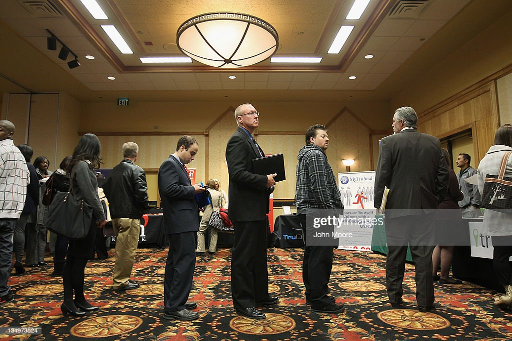 Job applicants wait in line to meet potential employers at the 'Denver Hires Job Fair' on December 5, 2011 in Denver, Colorado. Last week the U.S. government announced that the national unemployment rate has fallen to 8.6 percent, lower than most analysts had predicted and the lowest since 2009.