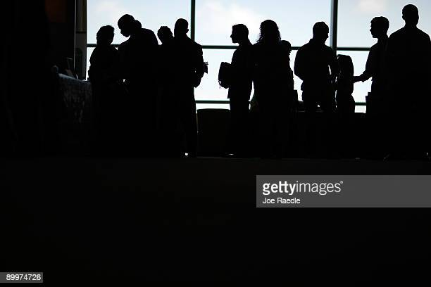 Job applicants wait to speak to recruiters during the RecruitMilitary Career Fair at Land Shark Stadium on August 20 2009 in Miami Florida The Labor...