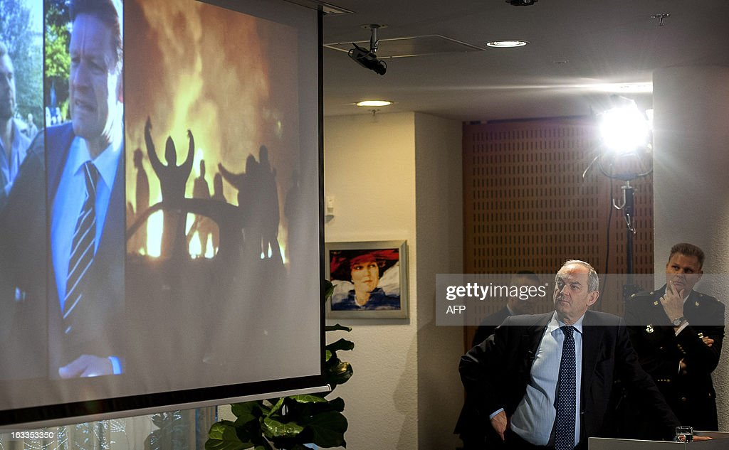 Job Cohen, the Chairman of a five-person commission to investigate the so-called 'Project X' riots, holds on March 8, 2013 a presentation in Haren, The Netherlands, of the investigation report on the riots that occured in Haren on September 21, 2012. Police and the mayor of a sleepy Dutch town 'failed' in their handling of a riot triggered when thousands attended a party after receiving a Facebook invitation meant to be private, a probe found on March 8. Some 4,000 revellers descended onto the northern town of Haren in September after a local girl accidentally posted a public invitation for her 16th birthday party on the social network. AFP PHOTO / ANP / CATRINUS VAN DER VEEN -- The Netherlands out --