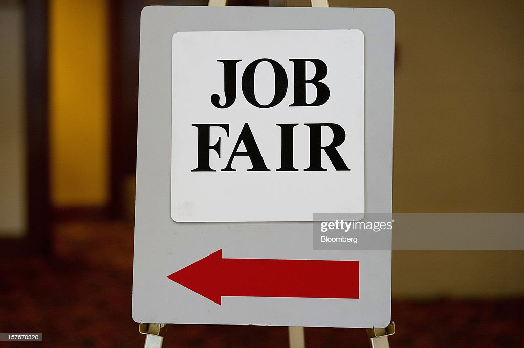 A job fair sign is displayed during a HIREvent job fair in San Jose, California, U.S., on Tuesday, Dec. 4, 2012. The U.S. Labor Department is scheduled to release initial jobless claims data on Dec. 6. Photographer: David Paul Morris/Bloomberg via Getty Images