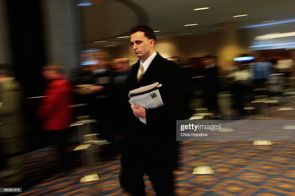 A job hopeful leaves the 'Keep America Working' job fair at the Marriot Marquis Hotel in Times Square on March 5, 2009 in New York City. Thousands of job applicants showed up for the fair sponsored by the job placement service Monster.com which will tour nationally around the country. New York City has lost tens of thousands of jobs, a great percentage in the finance sector, due to the economic crisis.
