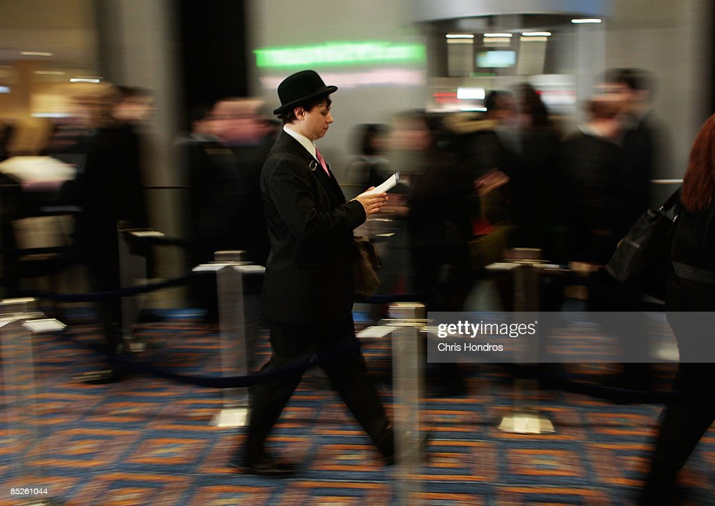 A job hopeful walks in line to enter the 'Keep America Working' job fair at the Marriot Marquis Hotel in Times Square on March 5, 2009 in New York City. Thousands of job applicants showed up for the fair sponsored by the job placement service Monster.com which will tour nationally around the country. New York City has lost tens of thousands of jobs, a great percentage in the finance sector, due to the economic crisis.