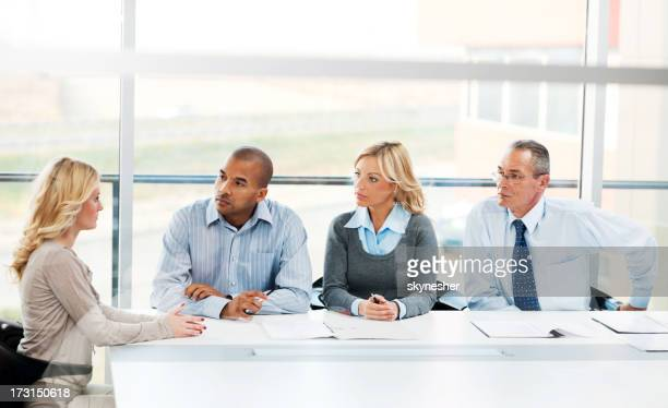 Job interview.  Group of businesspeople having a meeting.