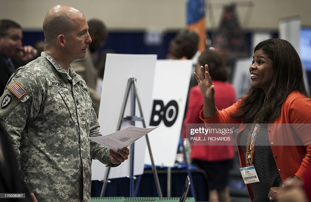 A job recruiter speaks with a soldier during a Hiring Our Heroes job fair June 11 at the Washington DC Convention Center The job fair was held in...