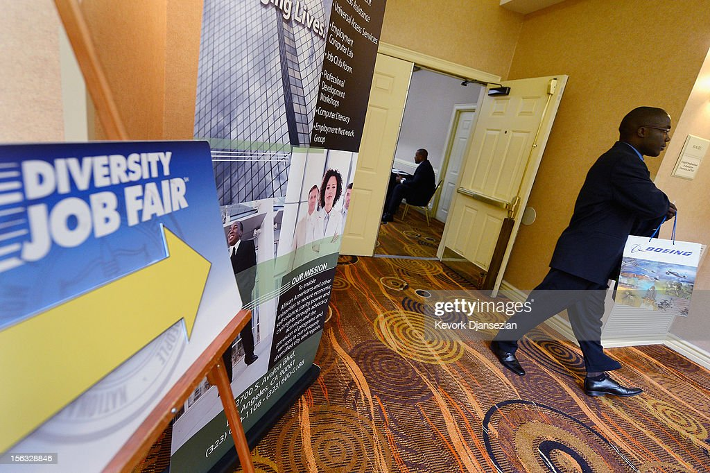 A job seeker attends the Professional and Executive Diversity Job Fair at a Embassy Suites hotel on November 13, 2012 in Los Angeles, California. According to reports, if Congress does not take action nearly 2 million unemployed workers are scheduled to lose their unemployment benefits at the end of 2012.