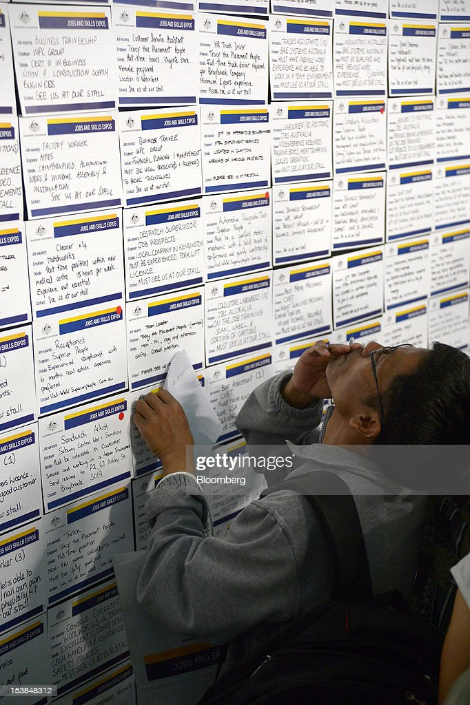 A job seeker browses job notices at a jobs and skills expo run by the Australian government in Melbourne, Australia, on Thursday, Oct. 4, 2012. Australia's unemployment rate probably climbed to 5.3 percent last month from 5.1 percent in August, according to the median estimate of economists surveyed by Bloomberg News. Photographer: Carla Gottgens/Bloomberg via Getty Images