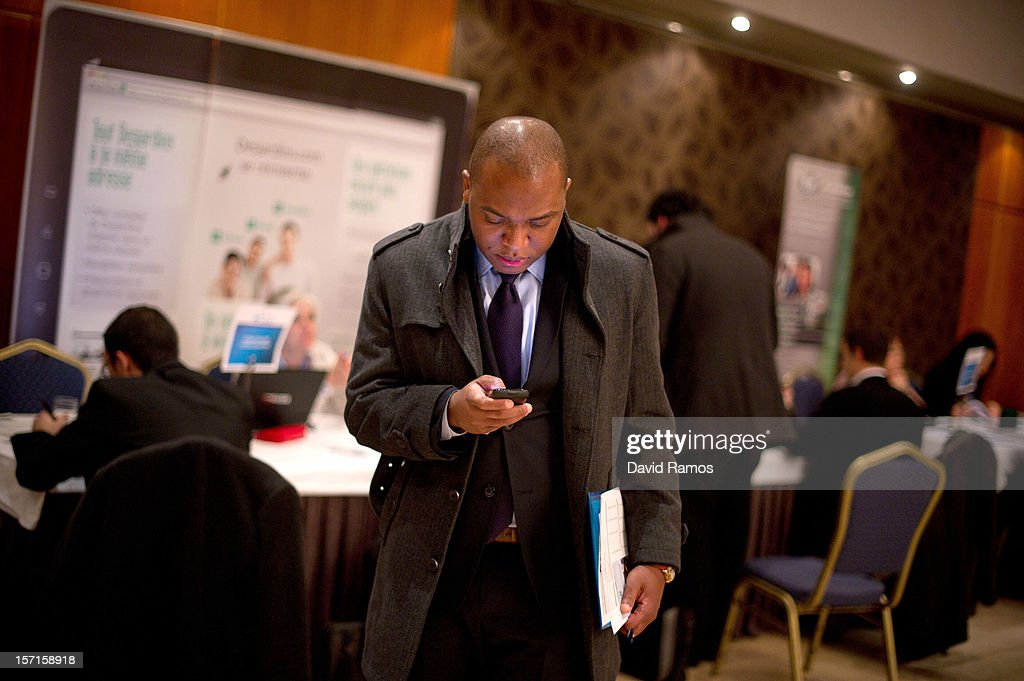 A job seeker checks his mobile phone during a Job fair organized by the ImmigrationOffice of Quebec in Paris and the Catalonia Employment Service (SOC) on November 29, 2012 in Barcelona, Spain. Over 40 companies from Quebec are offering more than 1000 jobs at two career fairs being held in Barcelona and Paris. Approximately 1300 job seekers attended today's fair in Barcelona after the unemployment rate in Spain increased to 25.02 percent in the third quarter of 2012, the highest in the EU.