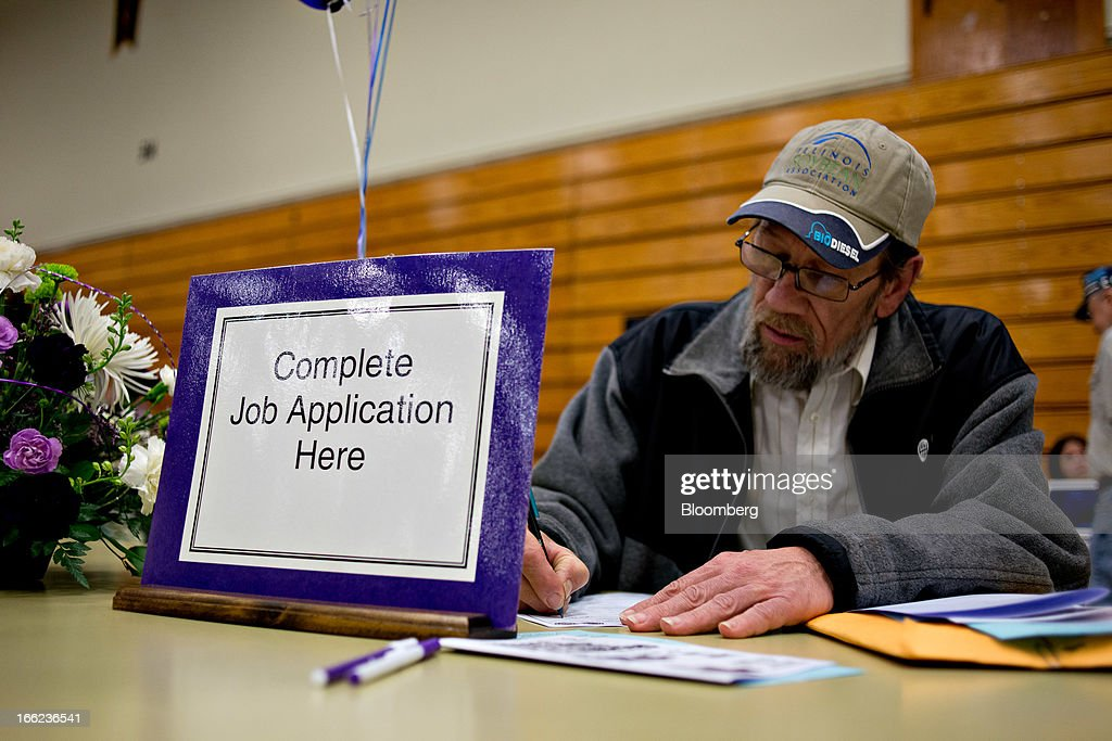 Job seeker Clinton Crouch, 58, who said he was laid-off in Sept. 2011, fills out an application for a maintenance job during a job fair at Illinois Valley Community College (IVCC) in Oglesby, Illinois, U.S., on Wednesday, April 10, 2013. The U.S. Department of Labor is scheduled to release jobless claims figures on April 11. Photographer: Daniel Acker/Bloomberg via Getty Images