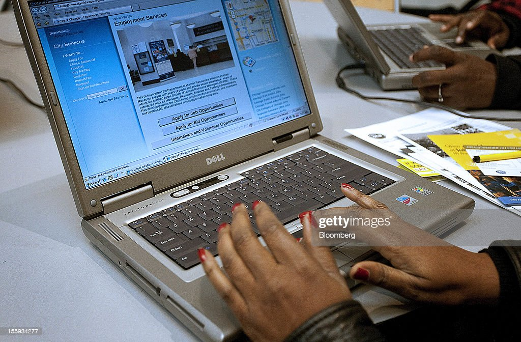 Job seeker Deardra Hughs uses a laptop computer to apply for jobs at the City of Chicago job fair at Kennedy King College in Chicago, Illinois, U.S., on Friday, Nov. 9, 2012. The U.S. Department of Labor is scheduled to release initial jobless claims data on Nov. 15. Photographer: Frank Polich/Bloomberg via Getty Images