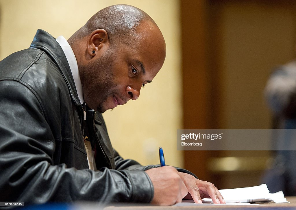 Job seeker Eldon McGee fills out an application during a HIREvent job fair in San Jose, California, U.S., on Tuesday, Dec. 4, 2012. The U.S. Labor Department is scheduled to release initial jobless claims data on Dec. 6. Photographer: David Paul Morris/Bloomberg via Getty Images