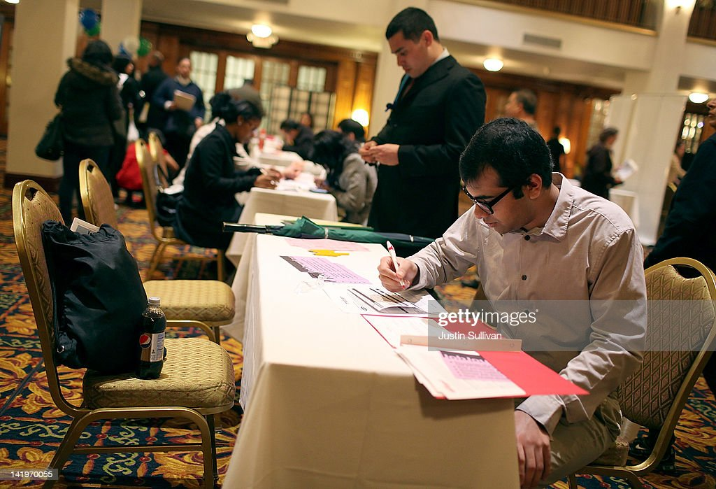 A job seeker fills out a job application during the San Francisco Hirevent job fair at the Hotel Whitcomb on March 27, 2012 in San Francisco, California. As the national unemployment rate stands at 8.3 percent, job seekers turned out to meet with recruiters at the San Francisco Hirevent job fair where hundreds of jobs were available.