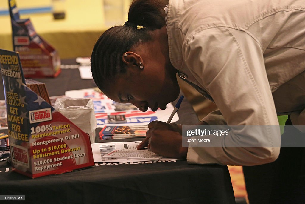 A job seeker fills out an application at a U.S. National Guard table at a career fair on April 18, 2013 at the Holiday Inn in Midtown in New York City. The event was held by National Career Fairs which expected some 700 job seekers would come to meet 20 potential employers.