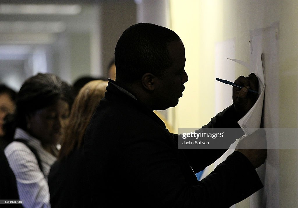 A job seeker fills out an application during a job fair hosted by the State of New York at the Shirley A. Chisholm State Office Building on April 12, 2012 in Brooklyn, New York. Thousands of job seekers lined up around the block to meet with recruiters at the one-day job fair that was one of 8 being held across the state.