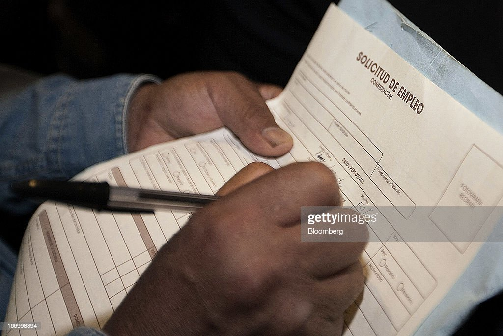A job seeker fills out an application during the XXVII job fair at the Palacio de los Deportes in Mexico City, Mexico, on Thursday, April 18, 2013. Mexico created 53,994 permanent and temporary urban jobs in March, according to reports from the Mexican Social Security Institute (IMSS). Photographer: Susana Gonzalez/Bloomberg via Getty Images
