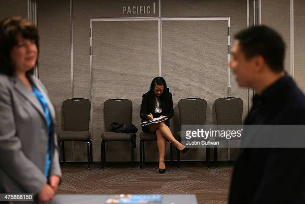 A job seeker fills out registration forms before entering a HireLive career fair on June 4 2015 in San Francisco California According to a report by...
