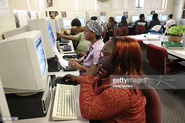 Job seeker Floxy Gold looks at a computer at the South Los Angeles WorkSource Center where US Commerce Secretary Gary Locke announced a $75 million...