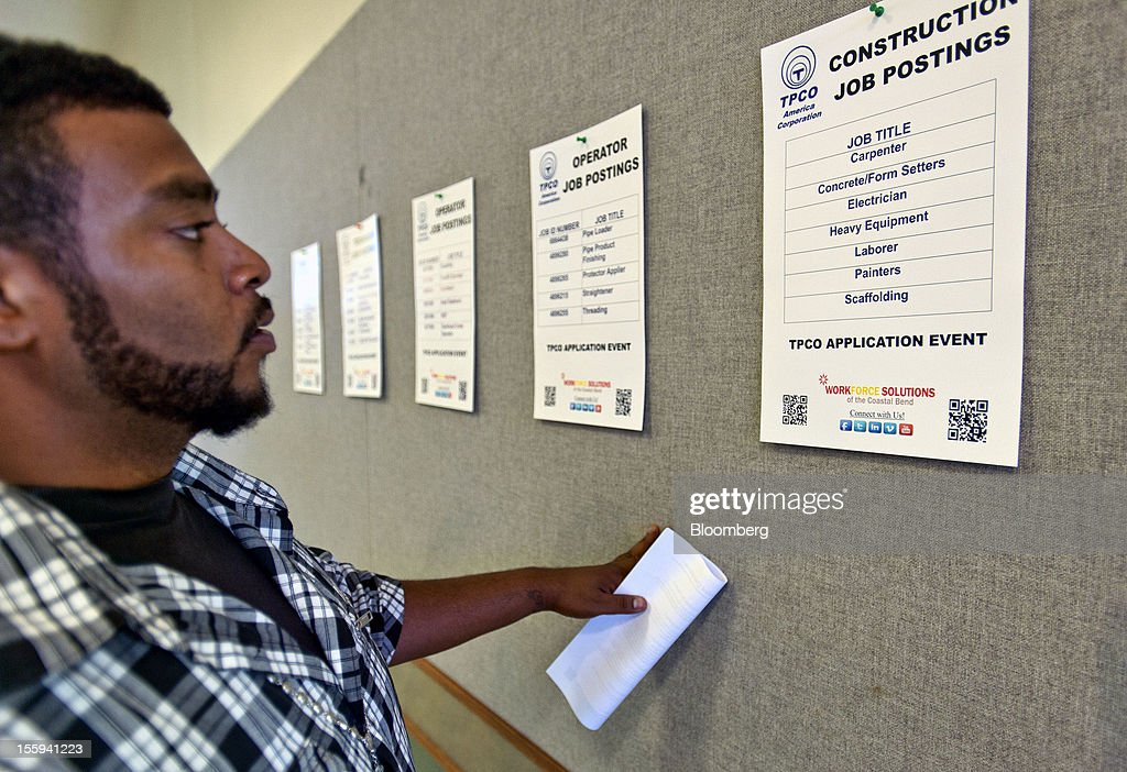 Job seeker Frank Hernandez looks at postings at a job application event for TPCO America Corp. in Portland, Texas, U.S., on Friday, Nov. 9, 2012. TPCO America Corp., a subsidiary of The Tianjin Pipe Group Corp., is a maker of seamless steel pipe used primarily in the energy industry. The U.S. Department of Labor is scheduled to release initial jobless claims data on Nov. 15. Photographer: Eddie Seal/Bloomberg via Getty Images