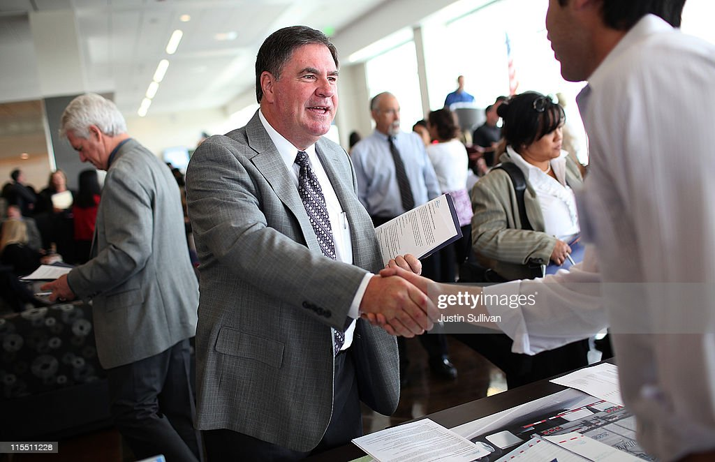 A job seeker greets a recruiter during the Job Hunter's Boot Camp at College of San Mateo on June 7, 2011 in San Mateo, California. As the national unemployment rate sits at 9.1 percent, U.S. Rep. Jackie Speier (D-CA) hosted a Job Hunter's Boot Camp that attracted hundreds of job seekers.