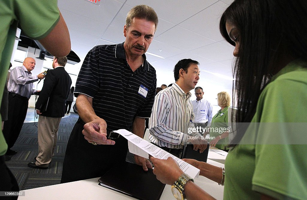 A job seeker hands his resume to a recruiter at a Dell career fair following a ribbon cutting ceremony to open the new Dell research and development facility on October 19, 2011 in Santa Clara, California. California governor Jerry Brown and Dell Chairman and CEO Michael Dell attended a ribbon cutting to open the new Dell research and development facility that was followed by a career fair to hire hundreds of employees for the new facilty.