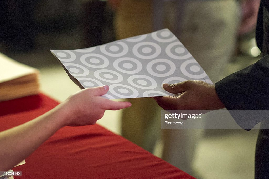 A job seeker hands in an application during a hiring event at a new store in San Francisco, California, U.S., on Thursday, Aug. 15, 2013. Claims for jobless benefits unexpectedly dropped by 15,000 to 320,000 in the week ended Aug. 10, the fewest since October 2007. Photographer: David Paul Morris/Bloomberg via Getty Images