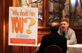 Job seeker has his resume reviewed during the San Francisco Hirevent job fair at the Hotel Whitmore on July 12 2011 in San Francisco California As...