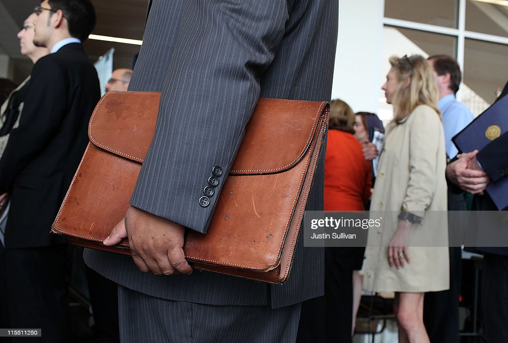 A job seeker holds a briefcase as he waits in line to meet with recruiters during the Job Hunter's Boot Camp at College of San Mateo on June 7, 2011 in San Mateo, California. As the national unemployment rate sits at 9.1 percent, U.S. Rep. Jackie Speier (D-CA) hosted a Job Hunter's Boot Camp that attracted hundreds of job seekers.