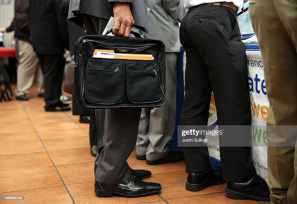 A job seeker holds a briefcase as he waits to meet with a recruiter during a job and career fair at City College of San Francisco southeast campus on May 30, 2013 in San Francisco, California. Hundreds of job seekers attended a career fair hosted by the San Francisco Southeast Community Facility Commission.