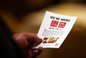 A job seeker holds a flier before meeting with a recruiter during a HIREvent job fair at the Hotel Whitcomb on July 10 2012 in San Francisco...