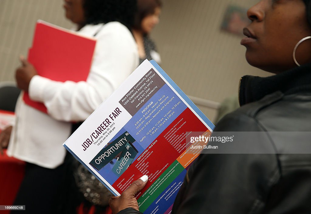 A job seeker holds a pamphlet during a job and career fair at City College of San Francisco southeast campus on May 30, 2013 in San Francisco, California. Hundreds of job seekers attended a career fair hosted by the San Francisco Southeast Community Facility Commission.