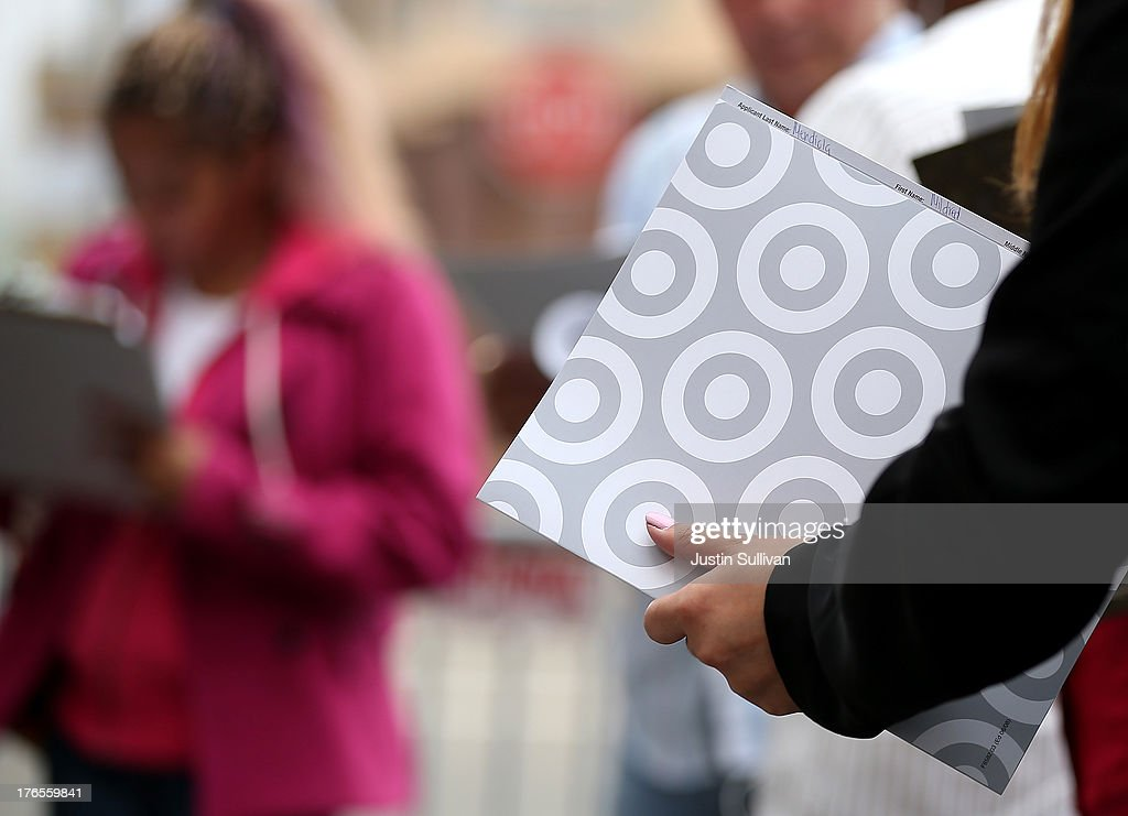 A job seeker holds a Target folder as she waits in line to enter a job fair at a new Target retail store on August 15, 2013 in San Francisco, California. Hundreds of job seekers applied for jobs during a job fair to staff a new Target City store. According to a report by the Labor Department, the number of people seeking first time unemployment benefits fell to the lowest level since 2007 with initial jobless claims decreasing by 15,000 to 320,000.