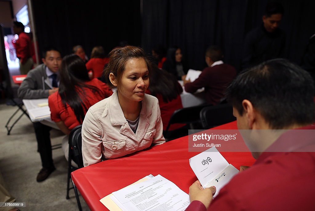 A job seeker (L) is interviewed by a Target employee during a job fair at a new Target retail store on August 15, 2013 in San Francisco, California. Hundreds of job seekers applied for jobs during a job fair to staff a new Target City store. According to a report by the Labor Department, the number of people seeking first time unemployment benefits fell to the lowest level since 2007 with initial jobless claims decreasing by 15,000 to 320,000.