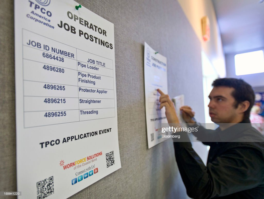 Job seeker Kenneth Story looks at postings during a job application event for TPCO America Corp. in Portland, Texas, U.S., on Friday, Nov. 9, 2012. TPCO America Corp., a subsidiary of The Tianjin Pipe Group Corp., is a maker of seamless steel pipe used primarily in the energy industry. The U.S. Department of Labor is scheduled to release initial jobless claims data on Nov. 15. Photographer: Eddie Seal/Bloomberg via Getty Images