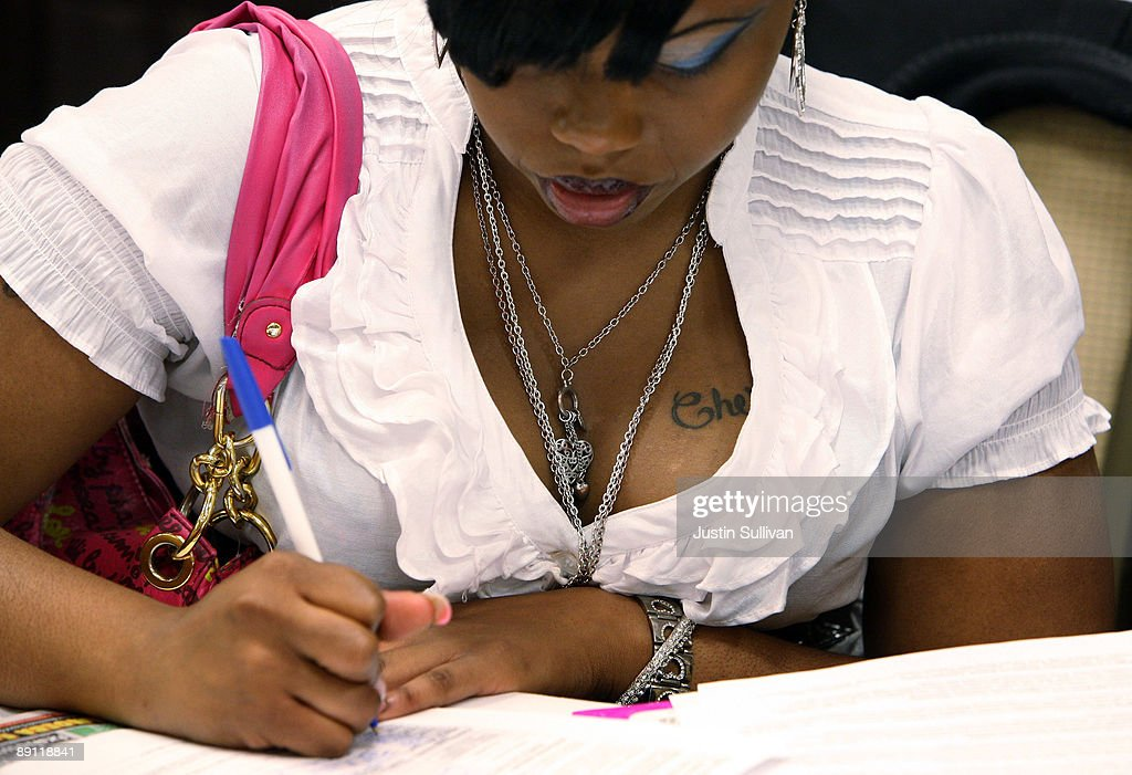 Job seeker LaShawn McCoy fills out an application during a job fair for the adult entertainment industry July 20, 2009 in San Francisco, California. Hundreds of job seekers attended a job fair that featured eleven San Francisco strip clubs offering jobs ranging from bartender and cashiers to exotic dancers and waitresses.