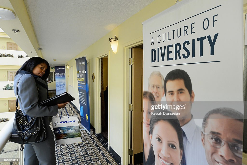Job seeker Latika Ross waits to speak with Bank of The West job recruiter during the Professional and Executive Diversity Job Fair at a Embassy Suites hotel on November 13, 2012 in Los Angeles, California. According to reports, if Congress does not take action nearly 2 million unemployed workers are scheduled to lose their unemployment benefits at the end of 2012.