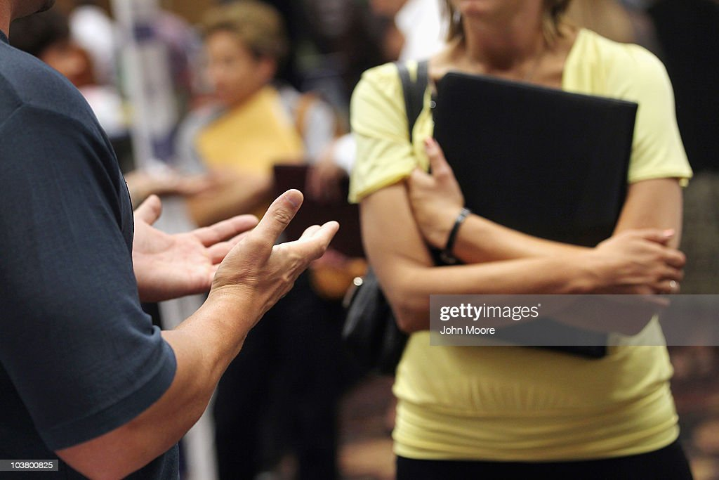 A job seeker (R), listens to a potential employer at a career fair on September 2, 2010 in Denver, Colorado. Hundreds of unemployed and underemployed Coloradans turned out for the event to try and find work. The federal government will announce its monthly national unemployment figures on Friday.
