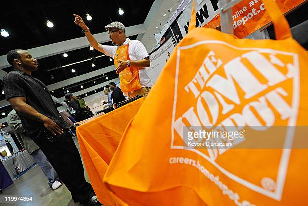 A job seeker listens to The Home Depot recruiter Andrew Rodriguez at the Diversity Job Fair during the NAACP's 102nd annual national convention at...