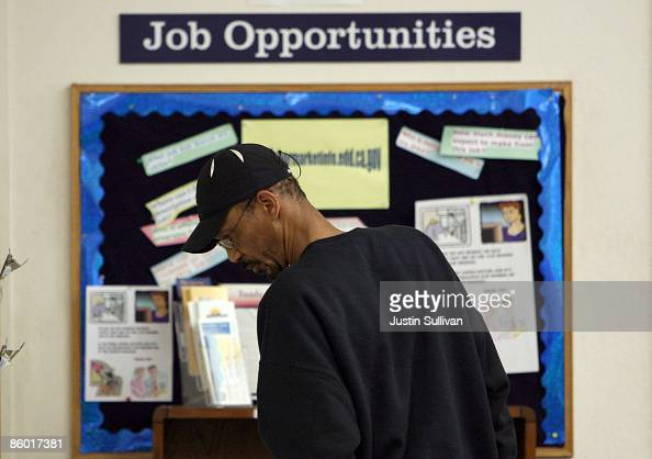 A job seeker looks at job listings posted at the East Bay Works OneStop Career Center April 17 2009 in Oakland California The California state...
