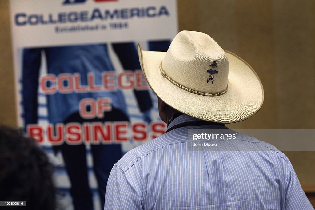 A job seeker looks over a booth at a career fair on September 2, 2010 in Denver, Colorado. Hundreds of unemployed and underemployed Coloradans turned out for the event to try and find work. The federal government will announce its monthly national unemployment figures on Friday.