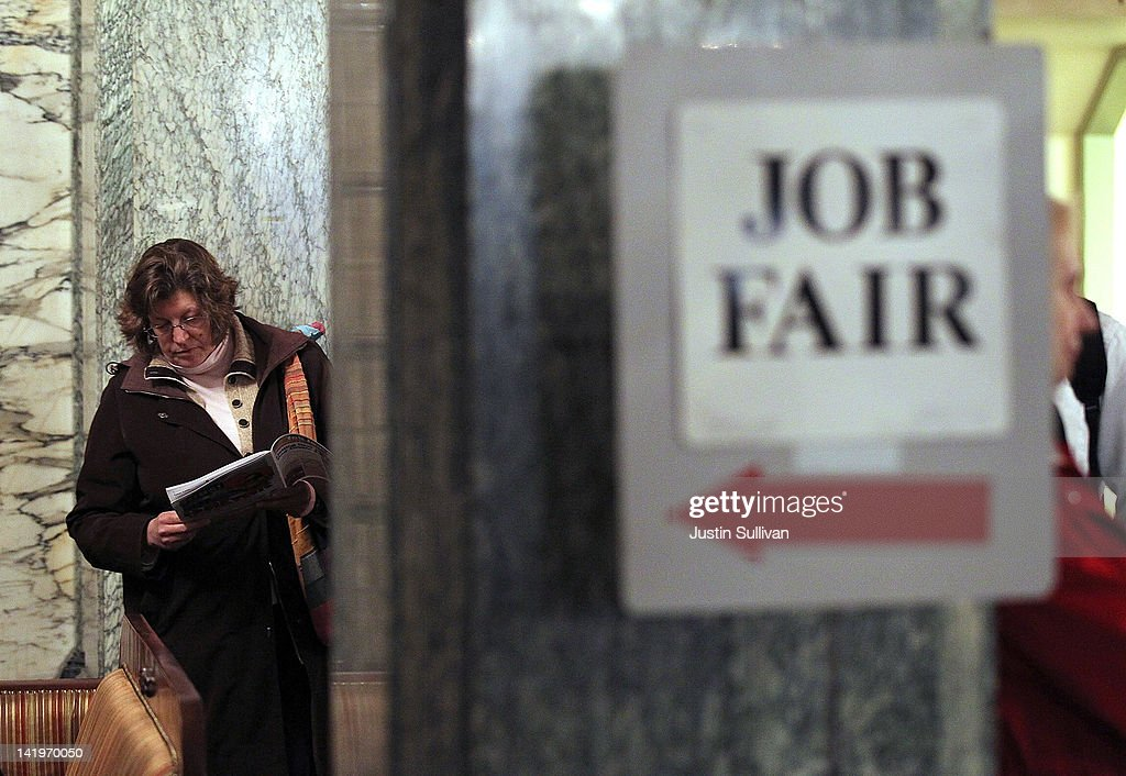 A job seeker looks over event materials as she waits to enter the San Francisco Hirevent job fair at the Hotel Whitcomb on March 27, 2012 in San Francisco, California. As the national unemployment rate stands at 8.3 percent, job seekers turned out to meet with recruiters at the San Francisco Hirevent job fair where hundreds of jobs were available.