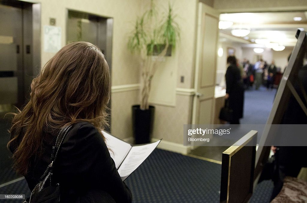 A job seeker looks over her resume before seeing recruiters at a job fair organized by United Career Fairs in New York, U.S., on Tuesday, Feb. 19, 2013. The U.S. Labor Department is scheduled to release initial jobless claims figures on Feb. 21. Photographer: Jin Lee/Bloomberg via Getty Images