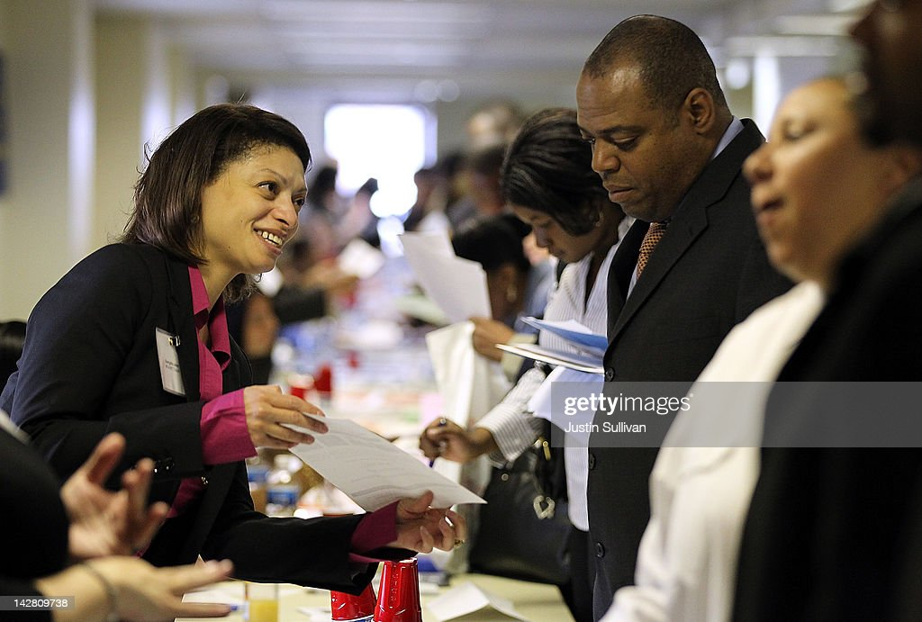 A job seeker meets with a recruiter during a job fair hosted by the State of New York at the Shirley A. Chisholm State Office Building on April 12, 2012 in Brooklyn, New York. Thousands of job seekers lined up around the block to meet with recruiters at the one-day job fair that was one of 8 being held across the state.