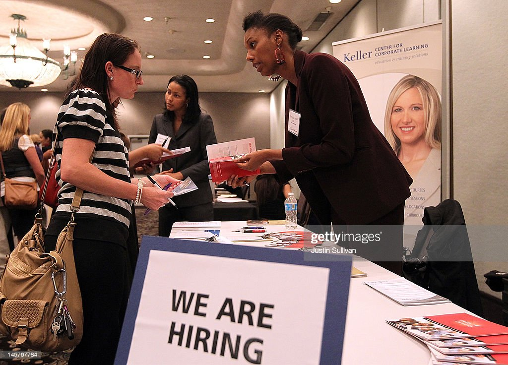 A job seeker meets with a recruiter during the East Bay HIREvent career fair at Centre Concord on June 5 2012 in Concord California Job seekers met...