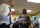 A job seeker meets with a recruiter during the East Bay's HIREvent on October 8 2013 in Emeryville California Dozens of job seekers attended the East...