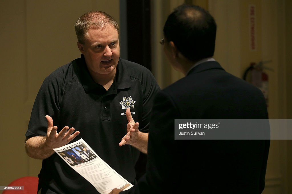 A job seeker meets with a recruiter during the HireLive Career Fair on November 12 2015 in San Francisco California The national unemployment rate...
