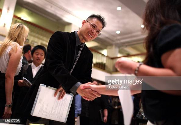 A job seeker meets with a recruiter during the San Francisco Hirevent job fair at the Hotel Whitmore on July 12 2011 in San Francisco California As...