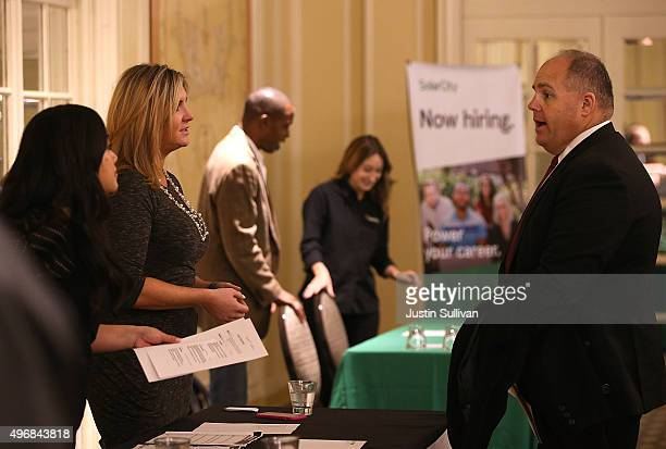 A job seeker meets with recruiters during the HireLive Career Fair on November 12 2015 in San Francisco California The national unemployment rate...