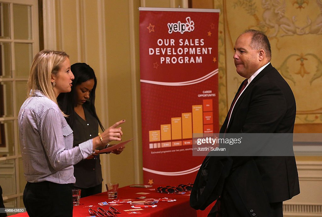 A job seeker meets with Yelp recruiters during the HireLive Career Fair on November 12 2015 in San Francisco California The national unemployment...