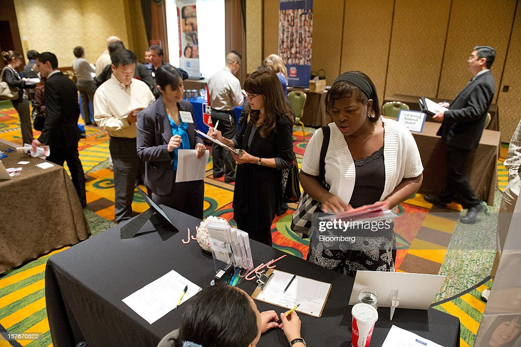 Job seeker Myeshia Riley, second from right, speaks to a recruiter during a HIREvent job fair in San Jose, California, U.S., on Tuesday, Dec. 4, 2012. The U.S. Labor Department is scheduled to release initial jobless claims data on Dec. 6. Photographer: David Paul Morris/Bloomberg via Getty Images